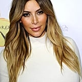 Kim Kardashian was out at the Dream For Future Africa Foundation Gala with her blond waves on full display.