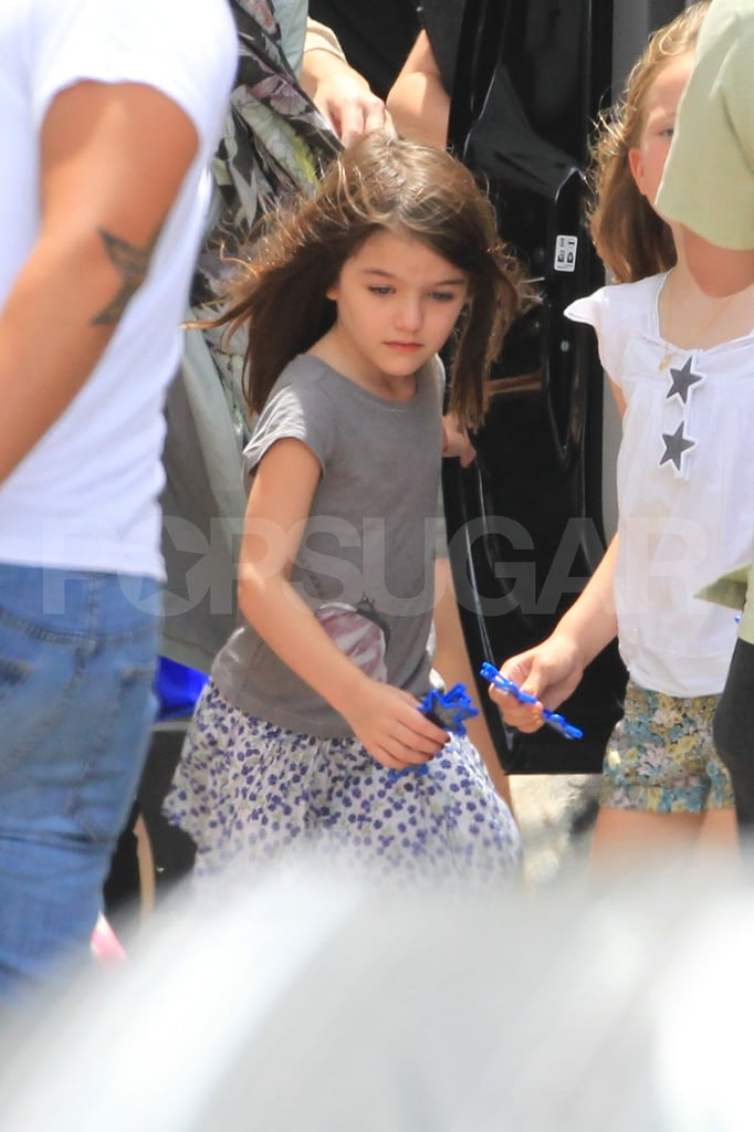 Suri Cruise carries star-shaped sunglasses.