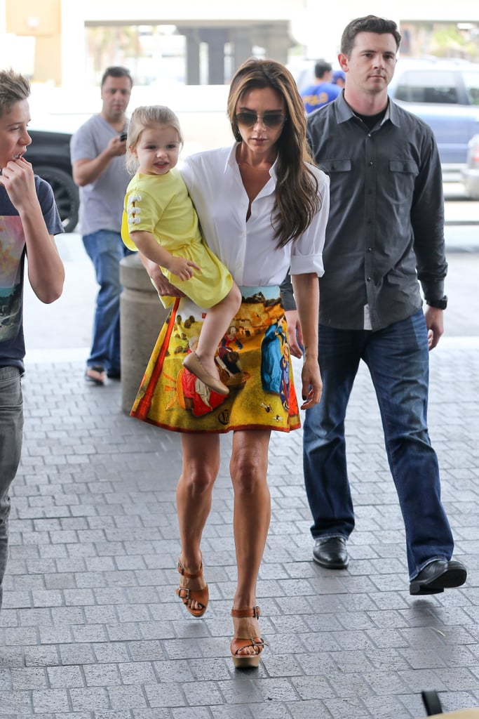 Harper and Victoria wore matching yellow tones arriving at LAX in June 2013.