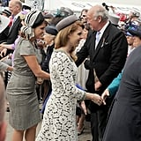 Princesses Eugenie and Beatrice greeted people at the races.