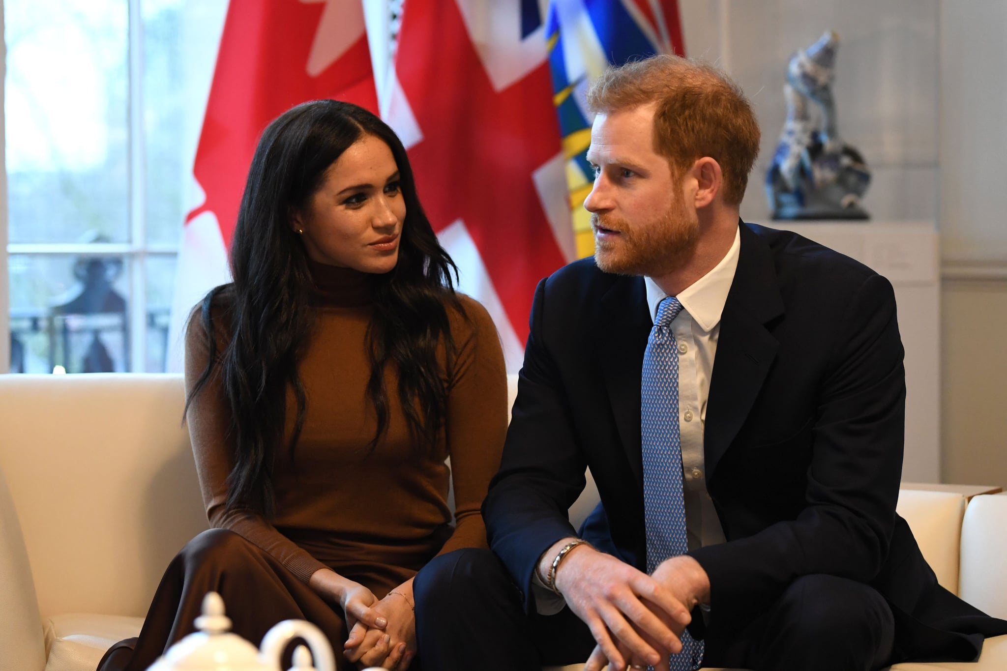 Britain's Prince Harry, Duke of Sussex and Meghan, Duchess of Sussex gesture during their visit to Canada House in thanks for the warm Canadian hospitality and support they received during their recent stay in Canada,  in London on January 7, 2020. (Photo by DANIEL LEAL-OLIVAS / various sources / AFP) (Photo by DANIEL LEAL-OLIVAS/AFP via Getty Images)