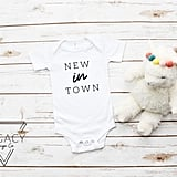 """New in Town"" Baby Onesie"
