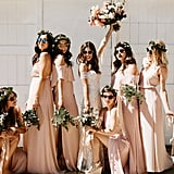 This sunglasses-clad group of bridesmaids all sported floor-length blush gowns.