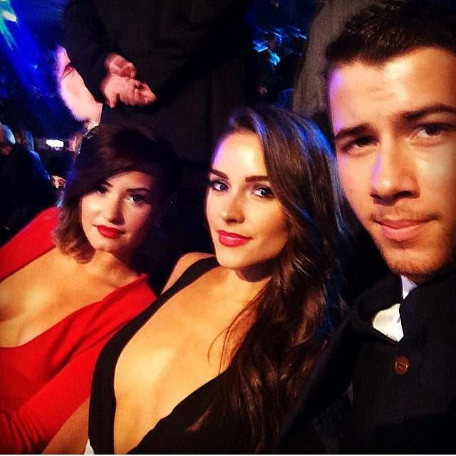 Cute couple Nick Jonas and Olivia Culpo got a picture with Demi Lovato.