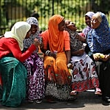 Young women laughed during a celebration at Burgess Park in London, England.