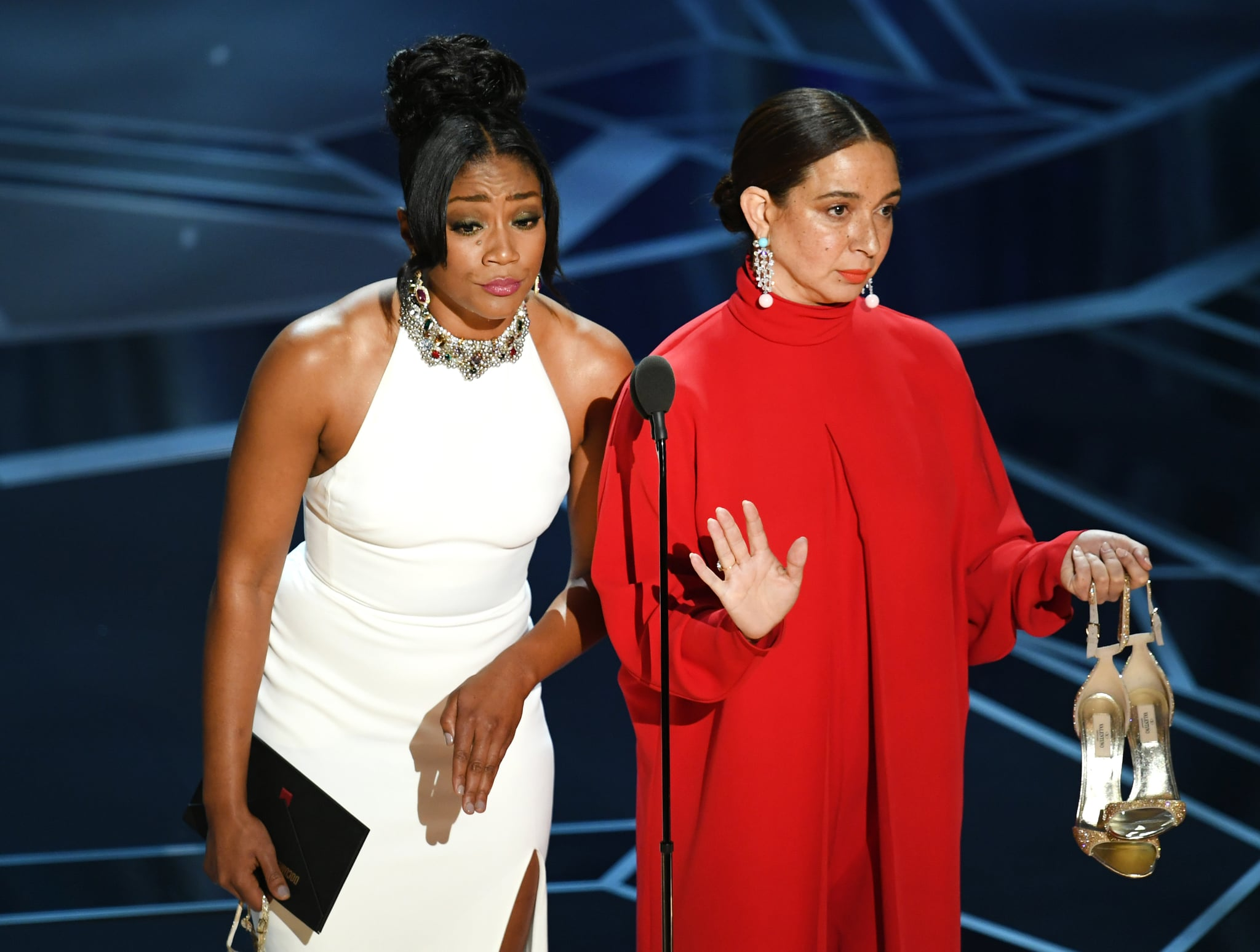 HOLLYWOOD, CA - MARCH 04:  Actors Tiffany Haddish (L) and Maya Rudolph speak onstage during the 90th Annual Academy Awards at the Dolby Theatre at Hollywood & Highland Center on March 4, 2018 in Hollywood, California.  (Photo by Kevin Winter/Getty Images)
