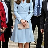 Kate visited the Dräi Eechelen Museum in Luxembourg on May 2017 and wore a pastel blue coat by Emilia Wickstead and LK Bennett beige pumps. She carried a matching nude clutch by Etui.