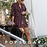 Miley Cyrus stepped out of her Miami hotel wearing a long plaid shirt.