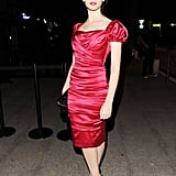 Felicity Jones opted for a fitted red ruched dress for her appearance at the Dolce & Gabbana's Gold restaurant.