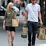 Kirsten Dunst smelled her flowers as she left a Whole Foods with Garrett Hedlund in NYC.