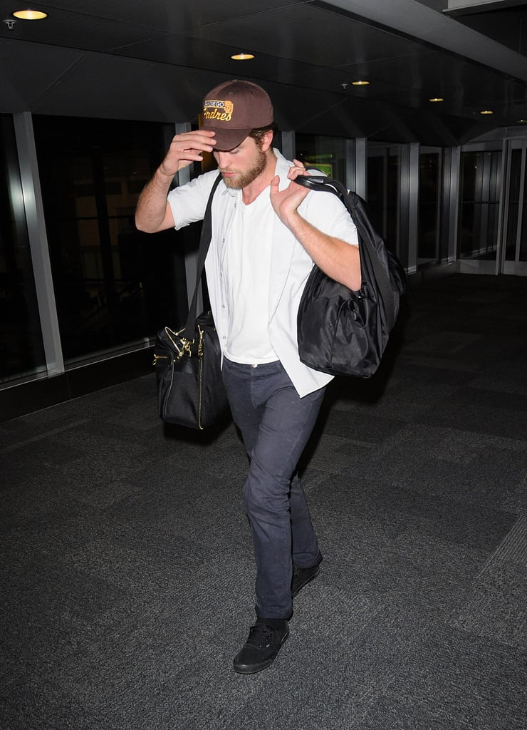 Robert Pattinson held onto his hat in Toronto.