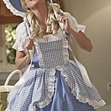 Claire goes Little Bo Peep for Halloween.