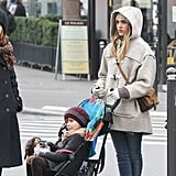 Another perfectly bundled look from layering master Jessica Alba: an oatmeal-hued toggle coat, complementing beanie, and cream leather gloves. She finished off her Parisian pairing with leather ankle boots and a tan suede crossbody.