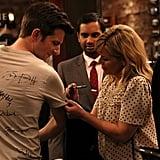 Some girl signs Ben's shirt.