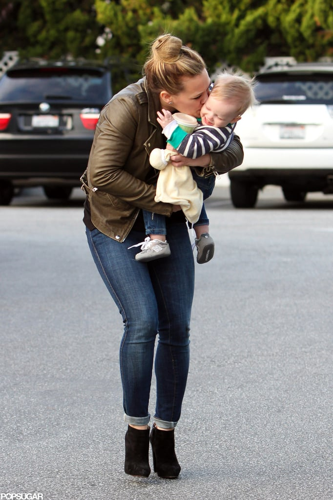 Hilary Duff planted a kiss on Luca Comrie's cheek.