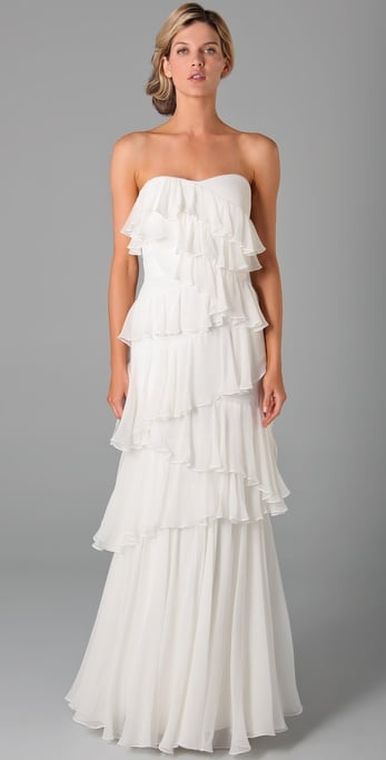 Ruffles are always a romantic go-to and we love the slim silhouette.  Notte By Marchesa Strapless Column Dress with Ruffles ($1,155)