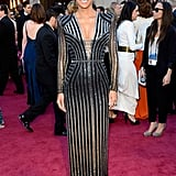 Halle Berry wowed in a Versace gown on the Oscars red carpet.