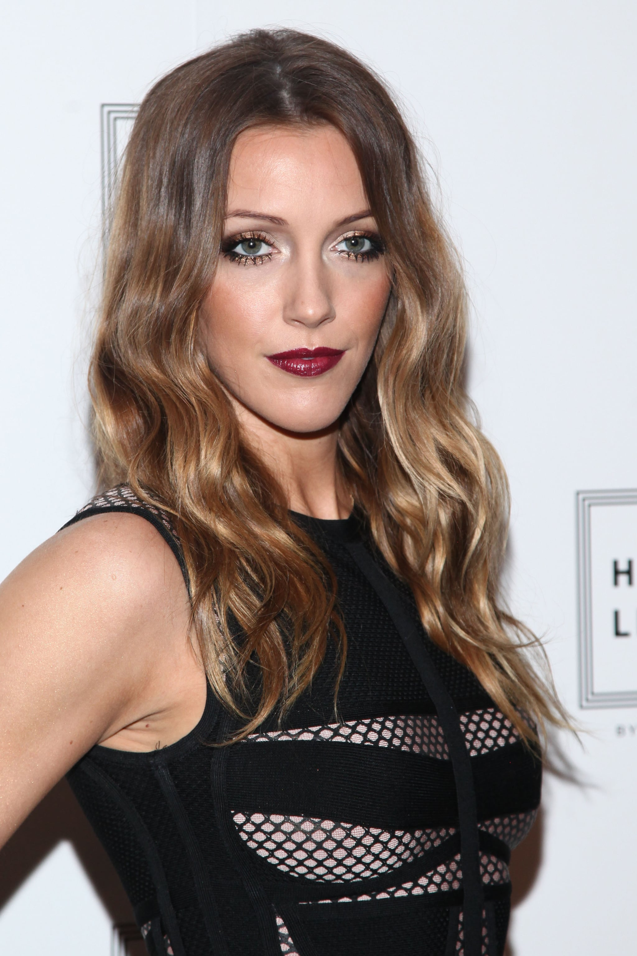 Katie Cassidy at Herve Leger by Max Azria Spring 2014.