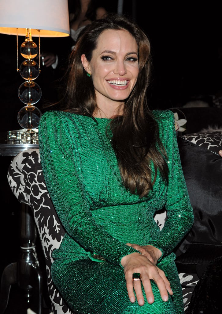 Angelina Jolie was all smiles at a Golden Globes afterparty hosted by Sony last night. She wore her gorgeous green dress to hang out with pals including director David Fincher, though she was without Brad Pitt, who she walked the red carpet with earlier in the evening. Andrew Garfield celebrated the success of The Social Network with costar Jesse Eisenberg, and also found time to catchup with his Spider-Man costar Emma Stone.