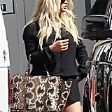 Jessica Simpson made her way through the cars in a parking lot.