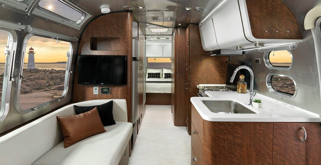 "There are travel trailers — and then there's the brand-new Airstream Globetrotter. This opulent ""Glamper"" is the perfect travel vehicle for the sophisticated family on the go. The 28-foot ""silver bullet"" boasts a surprisingly airy, modern minimalist layout with several floor plans to accommodate families of up to six people. Every amenity was designed with ease and luxury in mind, including the top-of-the-line kitchen and bathroom fixtures, abundance of charging ports, cozy dining banquette, and premium audio. ""With its sleek, clean lines, elegant features, and intentional touches, it surrounds you in a style that feels like it was made for you, elevating each and every adventure you set out on,"" Airstream's website reads. But this luxury comes at a cost; models start at $99,000 — yikes! Got wanderlust and deep pockets? Then this is the trailer for you. Peek inside the superluxe interiors ahead.      Related:                                                                                                           This Family of 4 Lives in a Converted Shuttle Bus — and I Really, Really Want In"