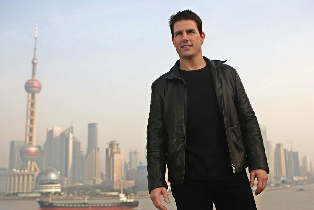 Tom Cruise got hot in a black leather jacket with a view of China behind him for the Mission: Impossible III press conference in November 2005.
