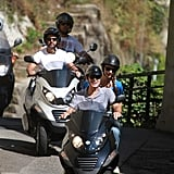 George Clooney and Stacy Keibler took a ride around Switzerland on scooters.