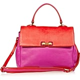 """""""Bold brights are everywhere for Spring, and Marc Jacobs's fuchsia and red clash-gone-cool handbag is a perfect way to get in on the trend. Not only can you use it to punch up go-to neutrals, but if you're feeling sartorially adventurous, mix it in with floral pants or contrasting hues!"""" — Liza Kaplan, senior producer, FabSugar TV  Marc by Marc Jacobs tote ($530)"""