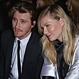 Garrett Hedlund and Kirsten Dunst attended the Saint Laurent Fall '13 runway show in Paris.