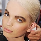 "Tom Pecheux, creative makeup director of Estée Lauder, created what he called a ""very fresh, glowy, earthy look."" Cheeks were defined with blush and Estée Lauder Gelée Bronzer (both launch early next year)."