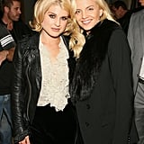 Blondies Kelly Osbourne and Mena Suvari are a fashionable pair at Intermix in LA.
