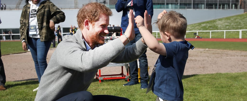 Your Heart Isn't Ready For Photos of Prince Harry Playing With an Adorable Little Kid