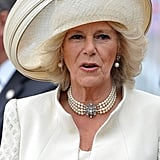 Camilla's jewels and Philip Treacy hat.