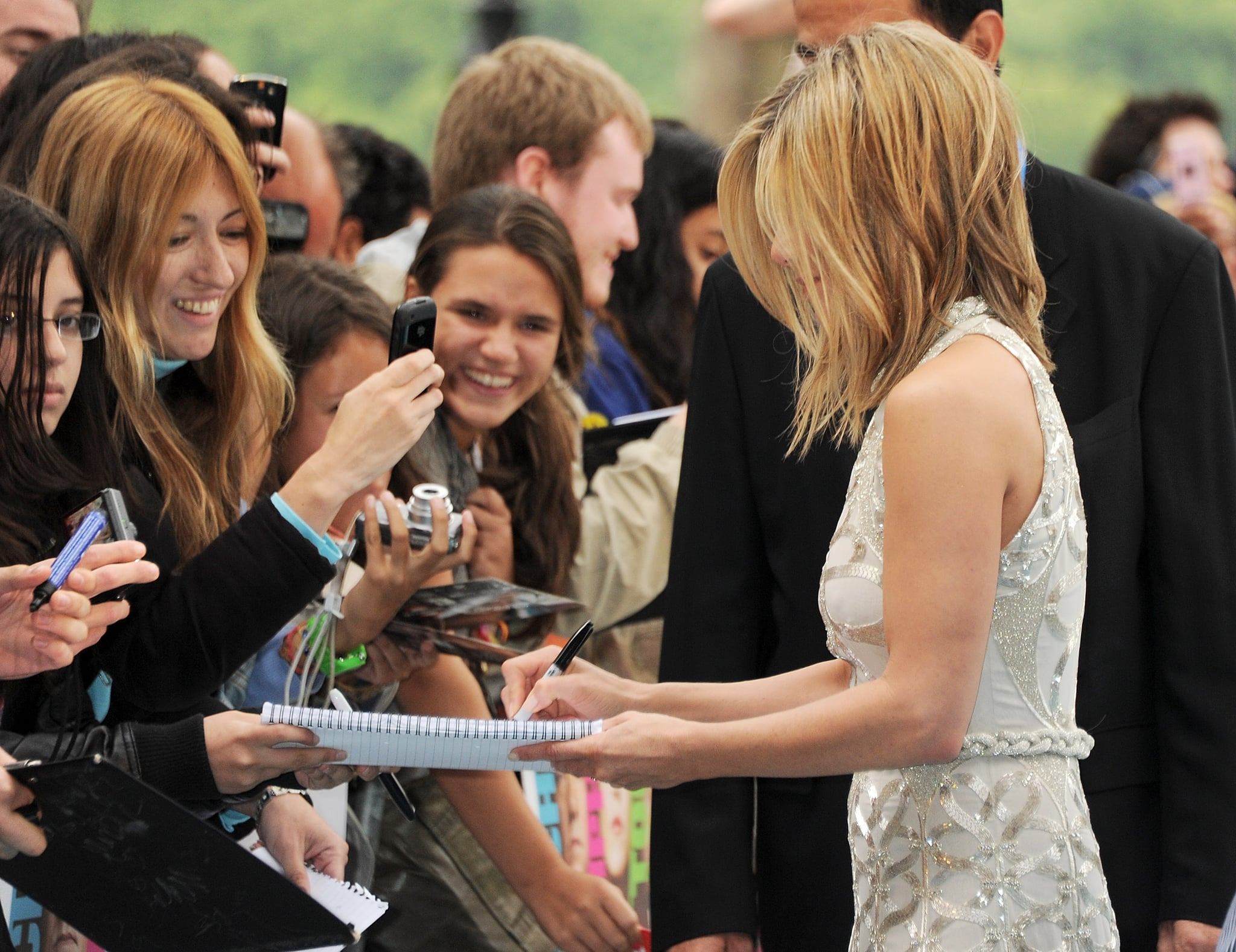 Jennifer Aniston signs autographs at the London premiere of Horrible Bosses.