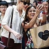 Taylor Swift delighted fans when she stopped for photos while shopping at Sydney's Pitt St Mall on November 25.