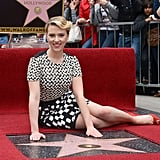 Scarlett Johansson proudly posed after being honored with her own star.