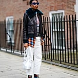 A Black Leather Jacket With Faux Fur, Checked Shirt, White Jeans, and Flower Print Boots