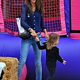 Alessandra Ambrosio and Anja Mazur held hands at a pumpkin patch.