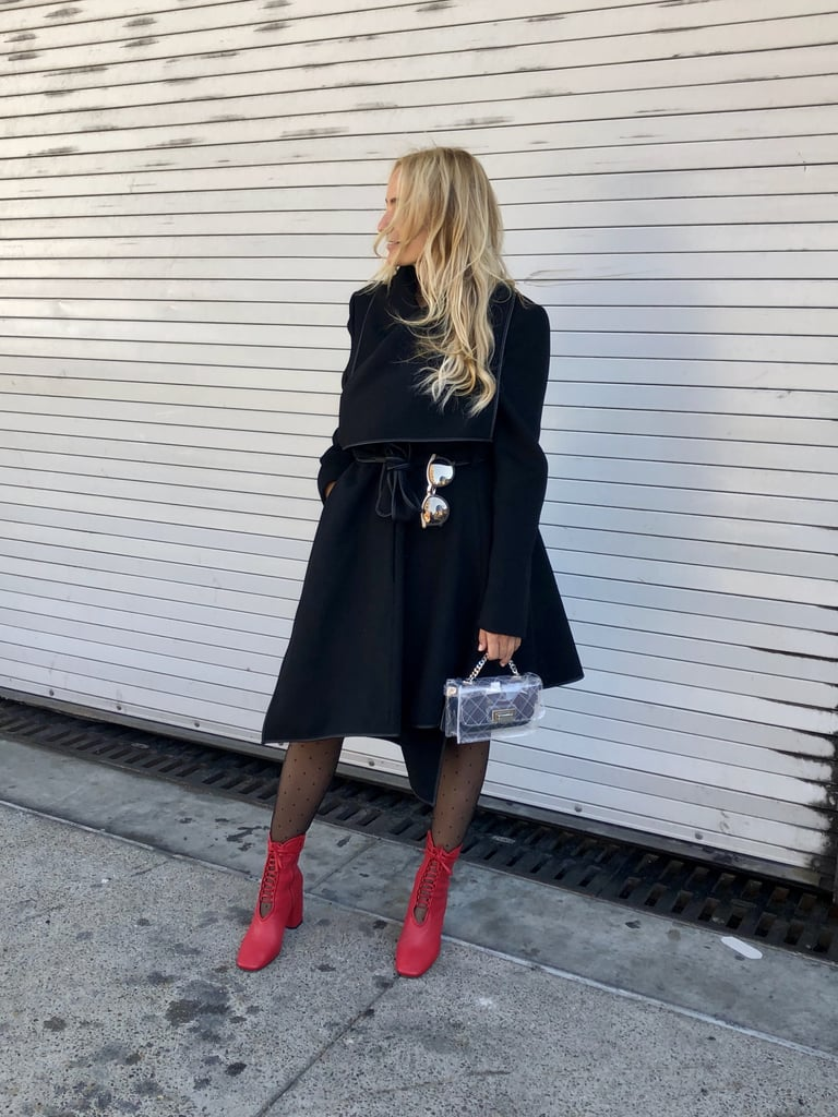 Adding red boots to a classic all-black outfit to give it a pop of color.