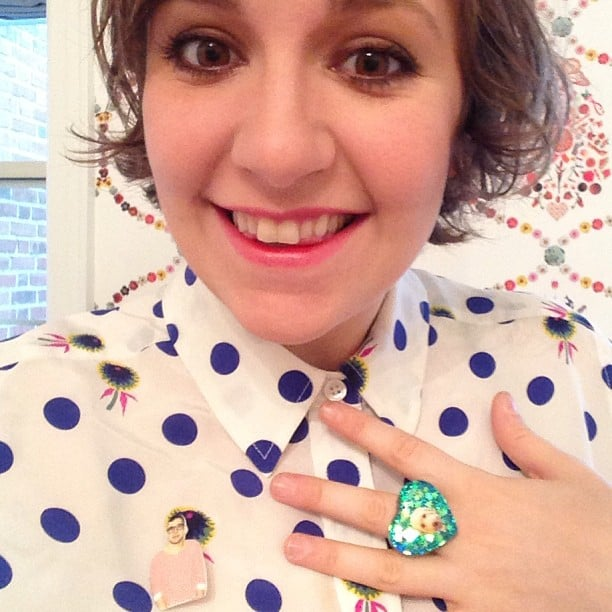 Lena Dunham showed off a pin with her boyfriend Jack Antonoff's face, and pretty new cocktail ring with a photo of her dog, Lamby. Source: Instagram user lenadunham