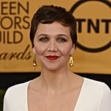 Maggie Gyllenhaal's architectural Fred Leighton pendant earrings were the golden touch to her all-white look.