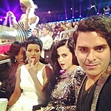 Rihanna and Katy Perry joked around in their seats. Source: Instagram user mdmolinari