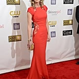 Helen Hunt showed some subtle skin with the lace insets on her red-hot Philip Armstrong gown.