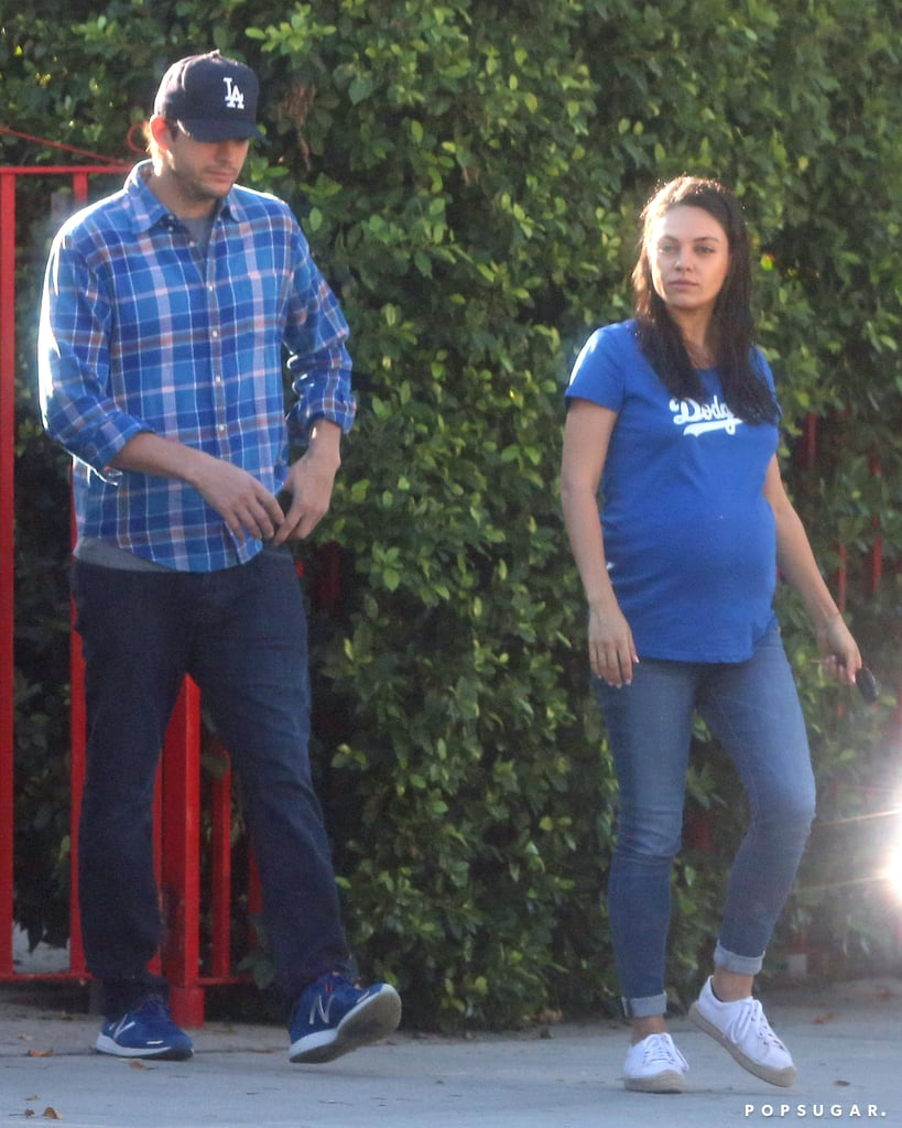 A fresh-faced Mila Kunis was spotted running errands with husband Ashton Kutcher in LA on Wednesday afternoon. The actress showed off her growing belly as well as her support for the LA Dodgers — who are only two wins away from advancing to the World Series — while Ashton demonstrated team spirit with his blue baseball cap. It was just the latest in a series of outings for the couple, who will be welcoming a baby boy in the coming months. After seemingly enjoying a sunny stroll in LA last month, the duo grabbed breakfast with their family, and more recently, they celebrated daughter Wyatt's second birthday.      Related:                                                                                                           Buns in the Oven: 21 Stars Who Are Expecting Babies in the New Year