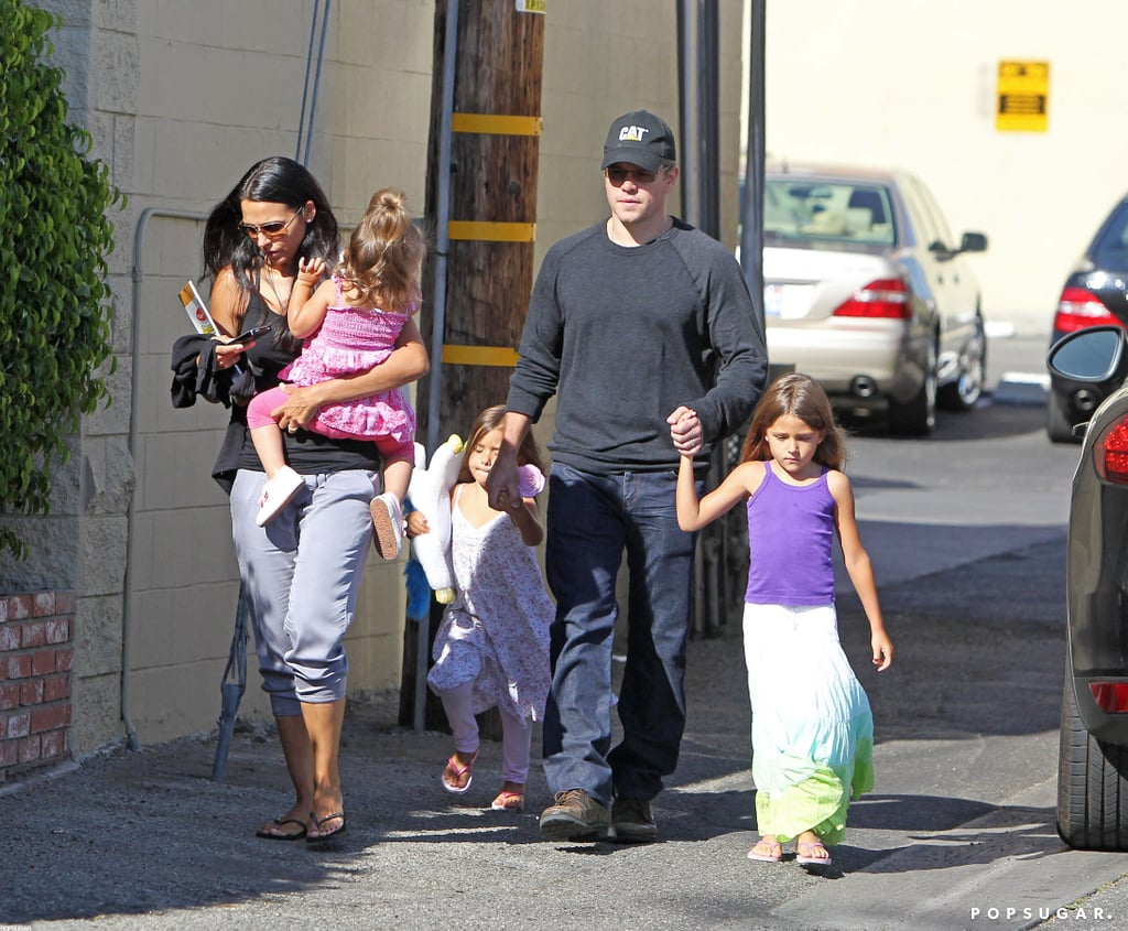 Matt Damon held hands with daughters Gia and Isabella yesterday, leaving lunch at Sor Tino Restaurant in Brentwood, CA. The actor was also joined by his wife Luciana, who carried their youngest daughter, Stella, in her arms. The Damon family is setting up a new residence on the West Coast with news that they've moved into a home down the street from Ben Affleck and Jennifer Garner. The Damons have a few more weeks to get situated before Matt makes the short trip to San Diego for this year's Comic-Con. He's scheduled to appear on the second day of the convention to chat about his futuristic thriller, Elysium.