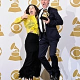Grammy winner Gordon Goodwin jumps for joy with his wife Lisa.
