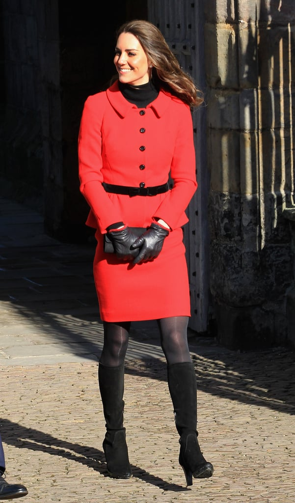 Sixteen years later, Kate chose a very similar ensemble — but in red and by Luisa Spagnoli — for a trip to her former university, St. Andrews.