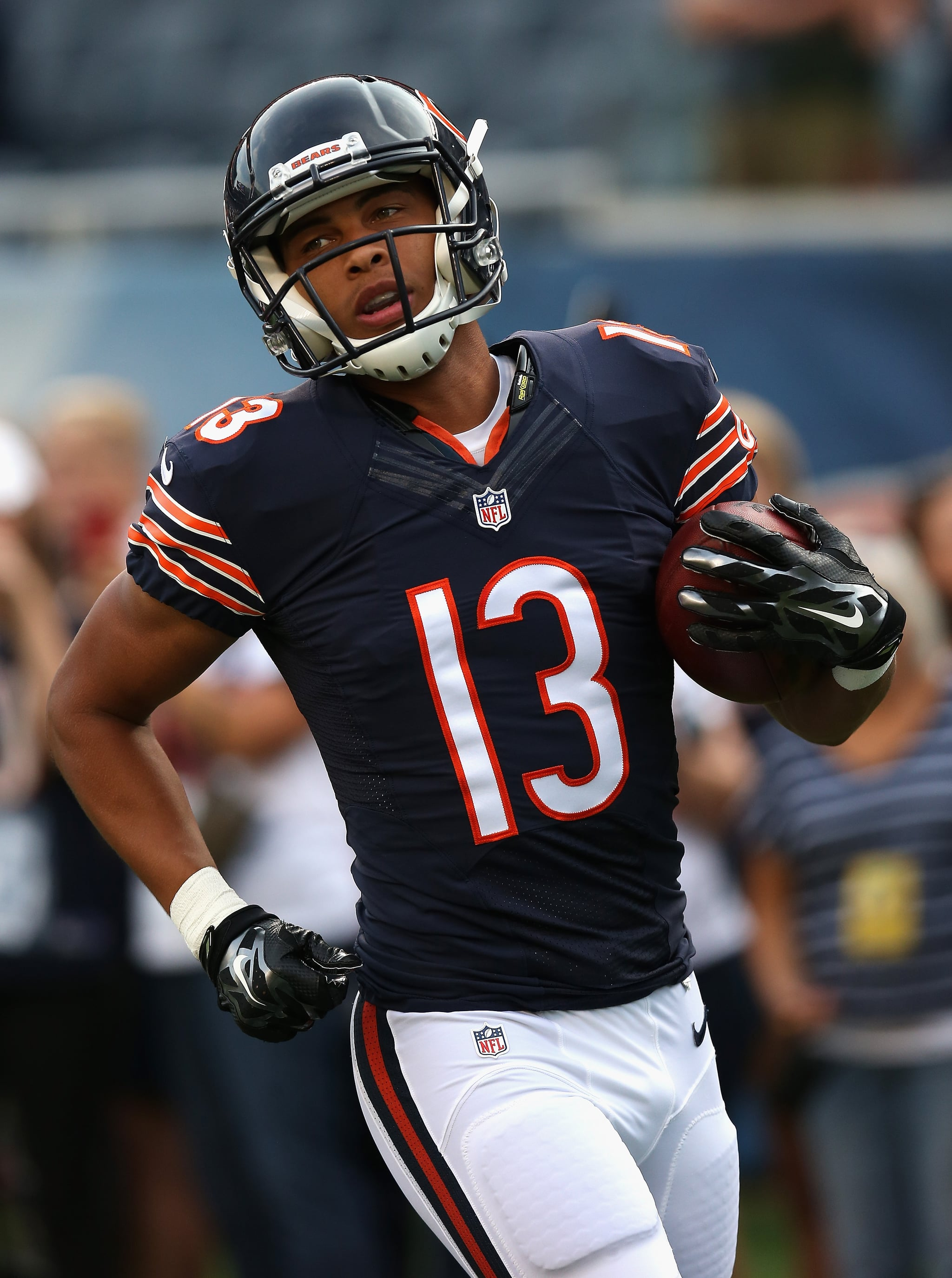 CHICAGO, IL - AUGUST 08:  Dale Moss #13 of the Chicago Bears participates in warm-ups before a preseason game against the Philadelphia Eagles at Soldier Field on August 8, 2014 in Chicago, Illinois. The Bears defeated the Eagles 34-28.  (Photo by Jonathan Daniel/Getty Images)