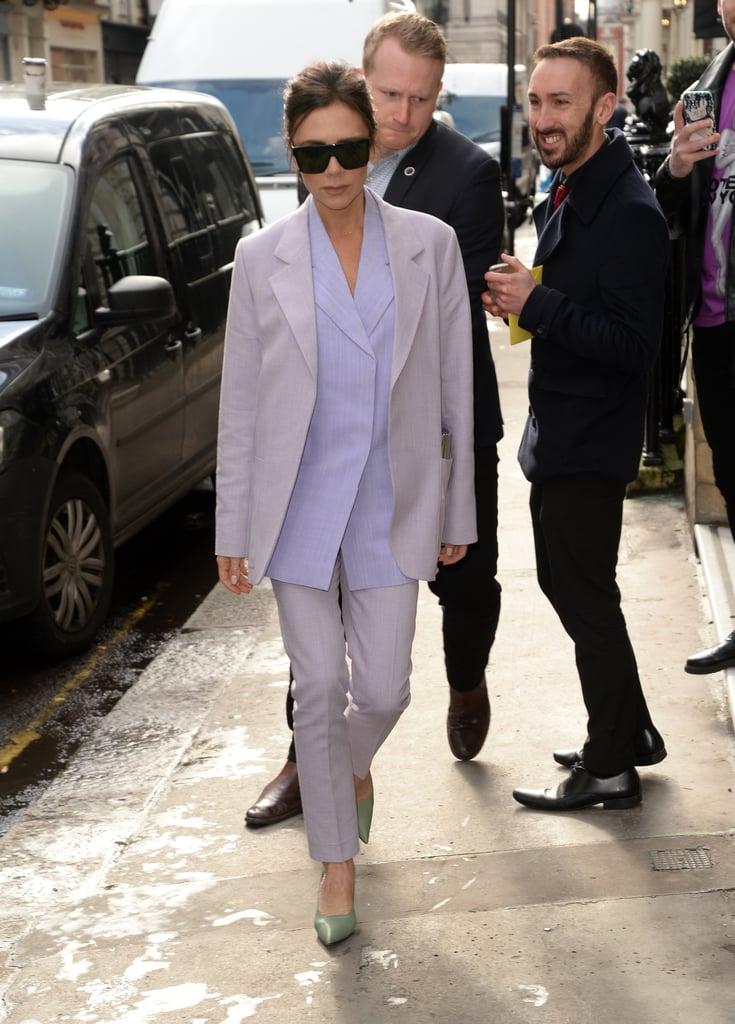Victoria Beckham Wearing a Purple Suit