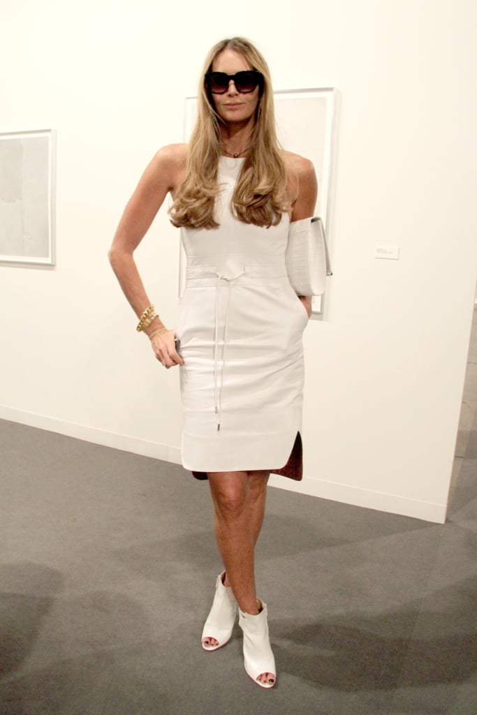 Elle Macpherson wore a white ensemble and sunglasses to see the exhibits at the Miami Beach Convention Center on Thursday.